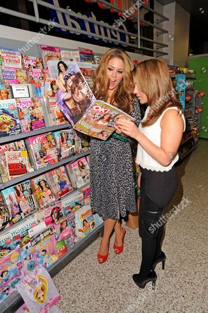 Bianca Gascoigne looking at 'OK' magazine with Layla Manoochehri