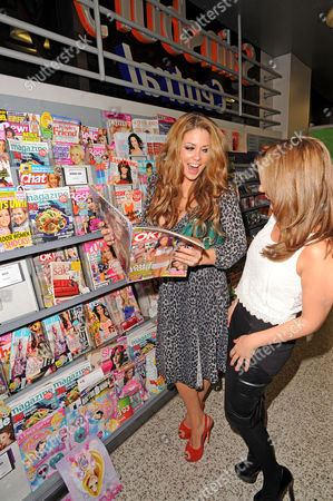 Stock Image of Bianca Gascoigne looking at 'OK' magazine with Layla Manoochehri