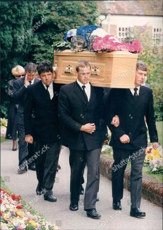 Stock Photo of Paul Warwick Funeral. Paul Warwick's Coffin With Racing Floral Tribute Carried To The Church Followed By Derek Warwick.