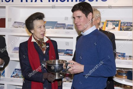 Stock Photo of HRH The Princess Anne presenting a trophy to Royal Yachting Association Yacht Master of the Year, Ifan James