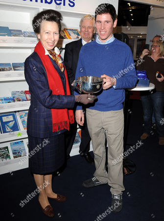 Stock Picture of Princess Anne presenting a trophy to Royal Yachting Association Yacht Master of the Year, Ifan James
