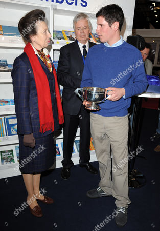 Stock Image of Princess Anne presenting a trophy to Royal Yachting Association Yacht Master of the Year, Ifan James