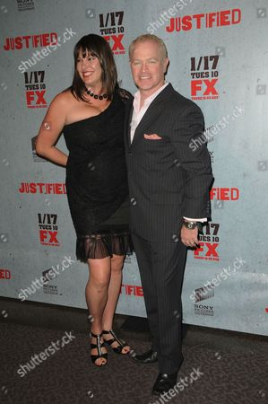 Stock Picture of Ruve Robertson and Neal McDonough