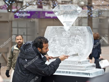 Sculptor Asanga Amerasinghe with an ice scuplture of a giant diamond made atop a Royal crest