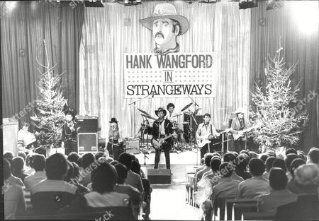 Singer Hank Wangford In Concert At Strangeways Prison Hank Wangford Is A Distinguished English Country And Western Songwriter. Hank Wangford Is The Stage Name Of Dr. Samuel Hutt (b.1940). His Music Is Notable For Its Humour And Cheerful Irony And Occasional Excursions Into Biting Political Undercurrent.