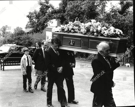 Editorial picture of Funeral Of Max Wall Comedian Showing His Coffin And Pall Bearers Highgate Cemetery 1990.
