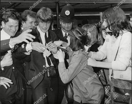 Gordon Waller Of Pop Duo Peter And Gordon Surrounded By Fans At London Airport 1964.
