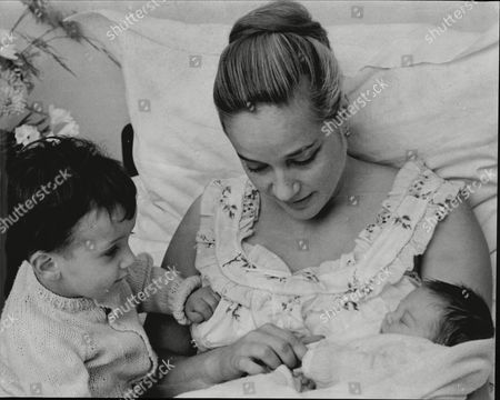 Editorial image of Sylvia Syms Actress In Bed With Her Her New Baby Daughter Beatrice Edney And Adopted Son Benjamin Edney 1962.