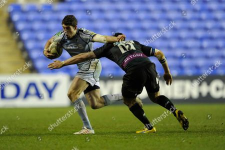 Alex Cuthbert of Cardiff Blues (left) attempts to hand off Shontayne Hape of London Irish