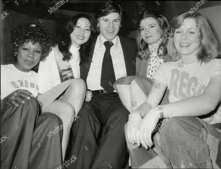 Alan Price Singer And Musician With International Girls From Various Stands At At Ideal Home Exhibition 1975- Beverley Hay Cindy Ng Melissa Flatt And Val Mitchell.