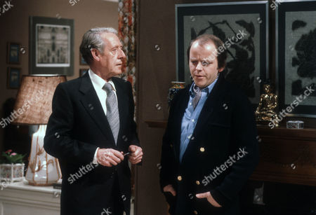 Robin Bailey as Alan Calcutt and Julian Holloway as Lawrence