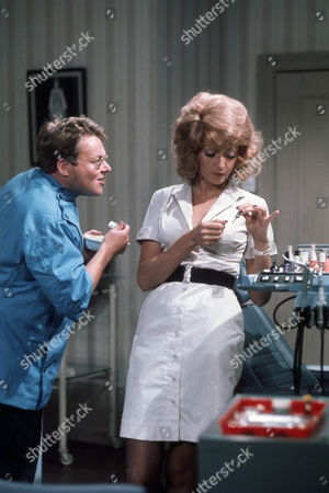 Bill Wallis as Aldous Hooper and Sharon Maughan (as Sharon Mughan) as Janine Lassoo