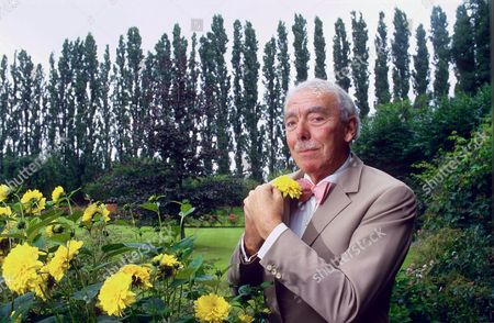 FRANK MUIR PICKING A FLOWER FOR HIS BUTTONHOLE