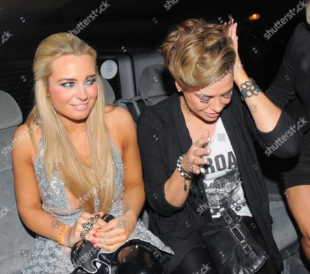 Amanda Harrington holding a bag with built-in rings, and Louise Glover