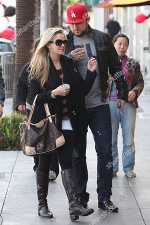 Editorial image of Tiffany Thornton and Chris Carney out and about in Beverly Hills, Los Angeles, America - 21 Jan 2012