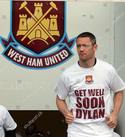 Kevin Nolan of West Ham United pays tribute to Martin Glover team player Dylan Tombides.