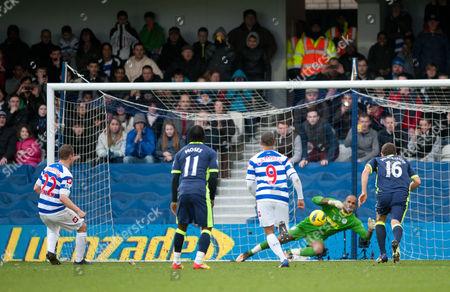 Heidar Helguson of QPR score the opening penalty goal
