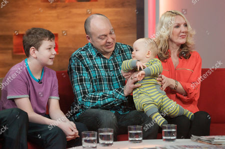Debbie Hughes and partner Paul Clarke with their new son Kyle and her other son Brandon aged 11