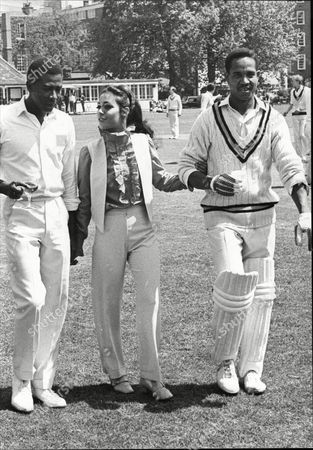 West Indian Skipper Sir Gary Sobers Who Now Skippers Nottinghamshire Is Seen In His New Role As A Film Actor. He Is Pictured During The Shooting Of Scenes For 'two Gentlemen Sharing At Westminster School Cricket Ground. With Him Is Esther Anderson One Of The Stars Of The Film.