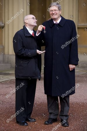 Phil Collins with brother Clive Collins who received the MBE for services to art