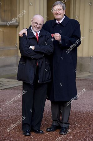 Stock Image of Phil Collins with brother Clive Collins who received the MBE for services to art