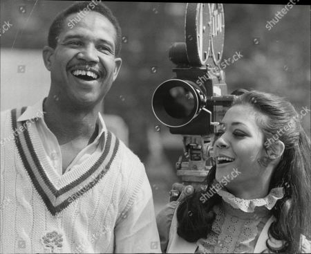 West Indian Skipper Sir Gary Sobers Who Now Skippers Nottinghamshire Is Seen In His New Role As A Film Actor. He Is Pictured During The Shooting Of Scenes For 'two Gentlemen Sharing' At Westminster School Cricket Ground. With Him Is Esther Anderson One Of The Stars Of The Film.