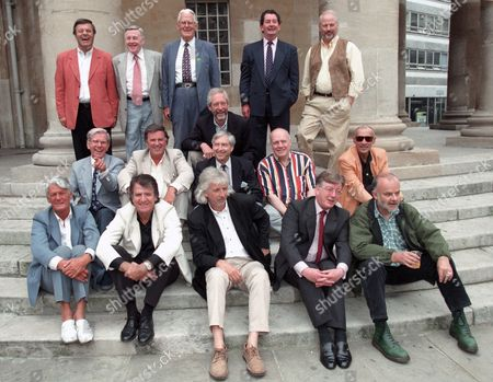 Former Radio 1 Disc Jockeys outside the BBC Broadcasting House. L-R top row: Tony Blackburn, Jimmy Young, Robin Scott, Dave Cash, Pete Brady. Middle row: Bob Holness, Sir Terry Wogan, Duncan Johnson, Keith Skews, Chris Denning, Pete Myers. Front row: Pete Murray, Ed Stewart, Pete Drummond, Mike A'Hearne, John Peel.