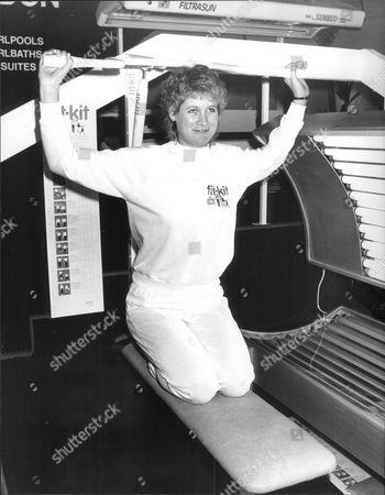 Julie Stevens Sports Studies Graduate Using Home Gym At Ideal Home Exhibition 1984.