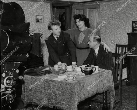 Tommy Steele Actor With Actor Charles Lamb And Actress Hilda Fenemore Who Play Tommy's Mother And Father In Film About His Life. Seen On Film Set At Beaconsfield Tommy Steele Obe (born Thomas William Hicks 17 December 1936 Bermondsey London) Is An English Entertainer. Steele Is Widely Regarded As Britain's First Teen Idol And Rock And Roll Star