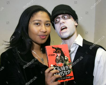J D Sharpe with her book 'Oliver Twisted' and husband David Nasralla