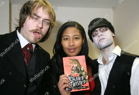 J D Sharpe (C) with her book 'Oliver Twisted', and characters from the book including husband David Nasralla (R)