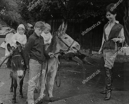 Lucille Soong Actress In Knee-high Leather Boots. Also Shows Children With Donkeys 1963.