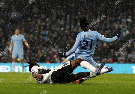 Dickson Etuhu of Fulham brings down David Silva of Manchester City put no penalty was awarded