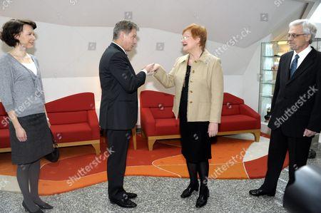 Stock Photo of Jenni Haukio with husband President-elect Sauli Niinisto, Finnish President Tarja Halonen and her husband Pentti Arajarvi