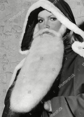 Actress And 1969 Miss World Eva Rueber Staier Dressed As Father Christmas. Eva Rueber-staier Is An Austrian Actress And Former Miss World. Rueber-staier Was Born In 1951 In Bruck An Der Mur Styria. She Won The Title Of Miss Austria And Participated In The Miss Universe Contest In 1969 In Which She Was A Top 15 Semifinalist. She Went On To Win The Miss World Pageant That Same Year. During Her Tenure She Starred In The Bob Hope Uso Tour In Vietnam.