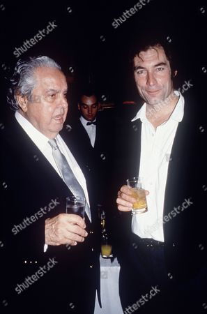 Albert Broccoli and Timothy Dalton