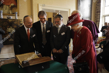 Stock Photo of Queen Elizabeth II is shown the Codex Valmadonna I book by Jewish guests, from left, President of Board of Deputies of British Jews Vivian Wineman, Chairman of Ostro Minerals Schweiz AG Maurice Ostro and Chief Rabbi of the United Hebrew Congregations of the Commonwealth Jonathan Sacks