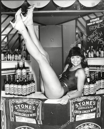 Julie Stevens Reigning Miss Lovely Legs Of Great Britain At The Ideal Home Exhibition 1984 On The Stone's Original Green Ginger Wine Exhibit.