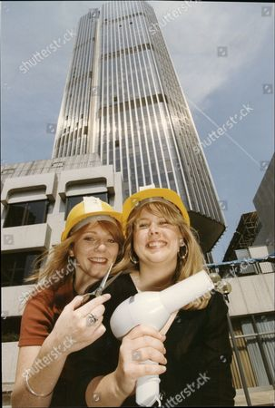 Kerry Taylor And Julie Burns Hairdressers Wearing Hard Hats In Front Of Natwest Tower 1993. Their Salon Fountain Court Was Damaged In Ira Bomb Blast.