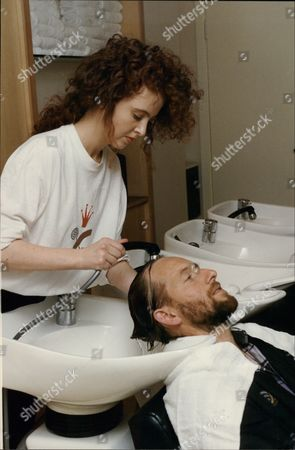 Mark Wallington Journalist Has Hair Washed Ready For Cut By Claire Robinson Of The Trevor Sorbie Salon 1990.
