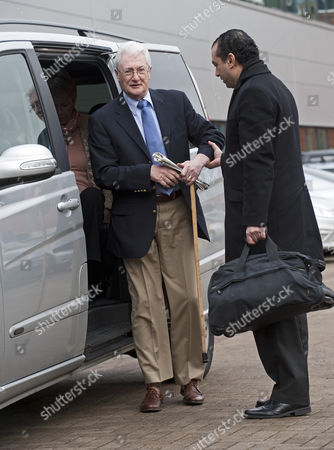 Christopher Tappin being helped from a taxi as he arrives at Heathrow Police station to surrender for extradition the the USA.