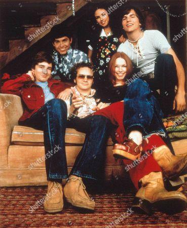 Stock Photo of That 70's Show ,  Topher Grace,  Wilmer Valderama,  Danny Masterson,  Mila Kunis,  Laura Prepon,  Ashton Kutcher