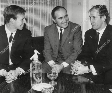 Manchester United Footballer Sir Bobby Charlton Robert Charlton (right) With Brother Jack Charlton (left) And England Manager Sir Alf Ramsey. Sir Robert 'bobby' Charlton Cbe (born 11 October 1937 In Ashington Northumberland) Is An English Former Professional Football Player A Member Of The England Team Who Won The World Cup And Ballon D'or For European Footballer Of The Year In 1966. He Played Almost All Of His Club Football At Manchester United Where He Became Renowned For His Attacking Instincts And Passing Abilities From Midfield And His Ferocious Long-range Shot. He Was Also Well Known For His Fitness And Stamina Allowing Him To Dominate The Pitch.