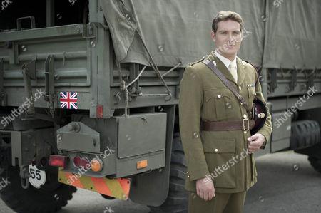 Mark Umber as Major Sir John Parker.