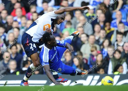 David N'Gog of Bolton Wanderers and Michael Essien of Chelsea
