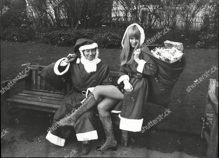 Actor And Comedian Reg Varney And Actress Moira Foot Dressed As Father Christmas For Television Christmas Programming