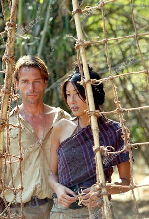 Stock Photo of Two Brothers,  Guy Pearce,  Mai Anh Le