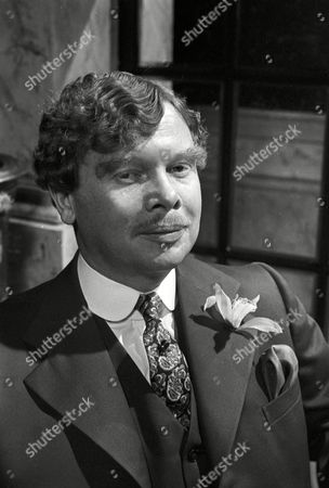 Ronald Lacey as Leicester Paton