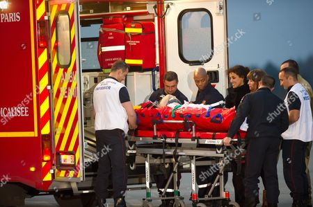 Edith Bouvier is taken on a stretcher to an ambulance