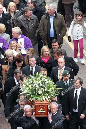 Deputy First Minister of Northern Ireland Martin McGuinness and TV presenter Eamonn Holmes carry the coffin